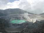 Looking into the crater of Volcán Poás - the green lake at bottom is about half a kilometer across and full of hot, acidic water. Mmmm, delicious.