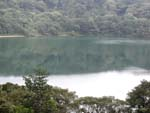 Laguna Botos, a lake filling an older crater farther up the volcano. Look out for falling stick figures.