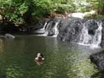 After a few hours of hiking in 300% humidity, Robyn enjoys a dip in a quiet jungle pool
