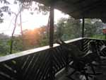 Relaxing before sunset on the porch of our bungalow